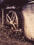 Old watermill wheel. Historical construction in rural region. Vintage style image Stock Image
