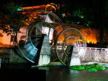 Old watermill wheel in Lijiang by night Stock Photos