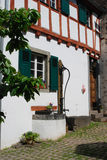 Old waterpump & woodframed house in Ediger Germany. Old historic waterpump & woodframed house in Ediger Mosel Germany Stock Images