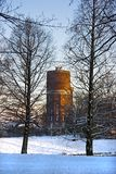 Old watertower with snow in winter Stock Photo