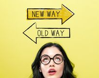 Old way or new way with young woman. Wearing eye glasses royalty free stock photography