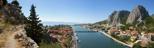 Old way to Omis (panorama). Omis - old city in Croatia. On one place you can see circuit of mountain, delta of river Cetina and Adriatic sea stock photos