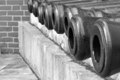 Old weapon trunks of ancient guns monochrome tone. Exhibits of old weapon trunks of ancient guns closeup of monochrome tone Stock Image
