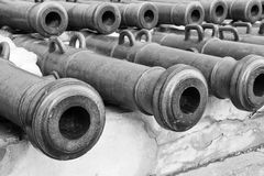 Old weapon trunks of ancient guns monochrome tone. Exhibits of old weapon trunks of ancient guns closeup of monochrome tone Royalty Free Stock Images