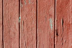 old weather-beaten red door, surface with chapped textured paint Stock Photo