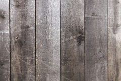 Old and weather worn brown wooden plank texture wall background. Wooden wall patterns from oak planks royalty free stock photo