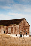 Old weathered bank barn Stock Photography