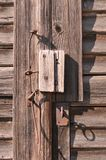 Old weathered barn door. Closeup of old weathered barn door with keyhole and key Royalty Free Stock Photo