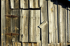 Old weathered barn door with rusty hinges Stock Photo