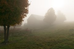 Old weathered barn on a foggy autumn morning Royalty Free Stock Photography