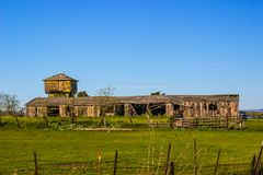 Old Weathered Barns In Need Of Repair Or Replacement. Old Weathered Wooden Barns In Need Of Repair Or Replacement stock photo