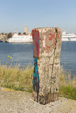 Old weathered and beautifully colored mooring pole Royalty Free Stock Photography