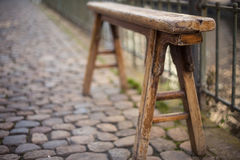 Old weathered bench on street Stock Image