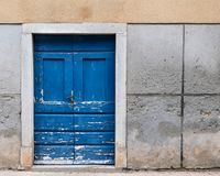 Old weathered blue door made of wood in Croatia. Island Cres royalty free stock photo