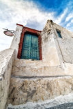 Old weathered blue door in Oia, Santorini, Cyclades, Greece Royalty Free Stock Image