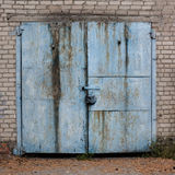 Old weathered blue garage doors. Stock Photo