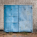 Old weathered blue garage doors. Royalty Free Stock Images