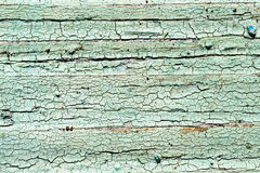 Old, weathered boards with peeling paint. Royalty Free Stock Image