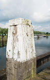 Old and weathered bollard from close Stock Image