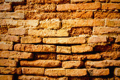 Old weathered brick wall fragment. Backgroud royalty free stock image