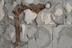 Old weathered brick wall fragment. brick in the wall, renovation of living space Royalty Free Stock Image