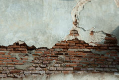 Old weathered brick wall fragment. Royalty Free Stock Photo