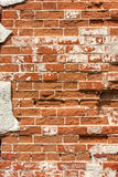 Old weathered brick wall, vertical grunge background Stock Image
