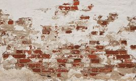 Old weathered brick wall with white plaster. Stone texture. Grunge background royalty free stock image