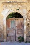 Old weathered broken wooden door, Greece stock photo