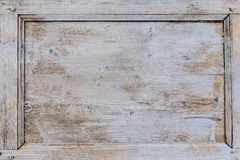 Old weathered brown door with cracked white paint background texture Royalty Free Stock Photography