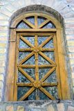Old and weathered brown window. Made from wood in a castle in Hungary stock photography
