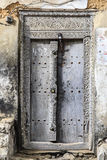 Old weathered carved traditional zanzibarian door Stock Image