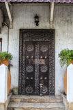 Old weathered carved traditional zanzibarian door Stock Images