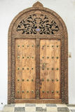 Old weathered carved traditional zanzibarian door Stock Photos
