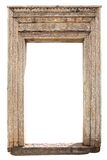 Old weathered carved wooden door frame Stock Photo