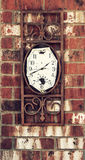 Old weathered clock on brick wall Royalty Free Stock Photos