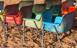 Old weathered colorful plastic chairs Royalty Free Stock Photography