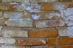 Old weathered cracked brick wall fragment square Royalty Free Stock Images
