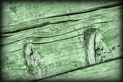 Old Weathered Cracked Knotted Kelly Green Pine Wood Floorboards Vignetted Grunge Texture.  Royalty Free Stock Image