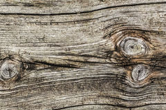 Old Weathered Cracked Rough Textured Knotted Plank Stock Photography