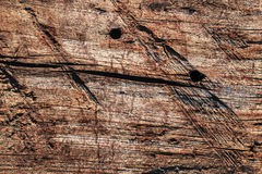 Old Weathered Wooden Railway Sleeper Rotten Cracked Drilled Grunge Surface Texture. Old, weathered, rotten, knotted Wooden Railroad Sleeper, with extremely rough Stock Images