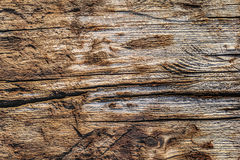 Old Weathered Wooden Railway Sleeper Rotten Cracked Drilled Grunge Surface Texture. Old, weathered, rotten, knotted Wooden Railroad Sleeper, with extremely rough Royalty Free Stock Photography