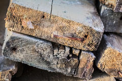 Heap Of Old Scrapped Weathered Cracked Rotten Decking Planks With Rusty Bent Nails Stock Photography
