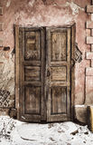Old weathered door. In abandoned building.Toned stock photography