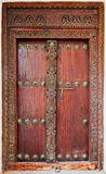 Old weathered door of building in Stone Town, Zanzibar. Old weathered carved traditional door of building in Stone Town, Zanzibar, Tanzania royalty free stock photo
