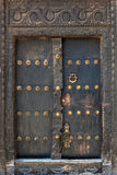 Old weathered door of building in Stone Town, Zanzibar Royalty Free Stock Images