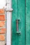 Old weathered door with knob. Stock Photos