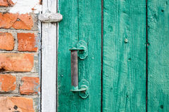 Old weathered door with knob. Royalty Free Stock Image