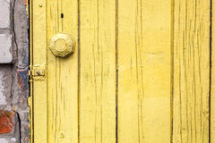 Old weathered door with knob. Royalty Free Stock Images