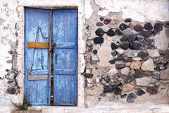 Old weathered door in Perissa, Santorini, Cyclades, Greece Royalty Free Stock Photos